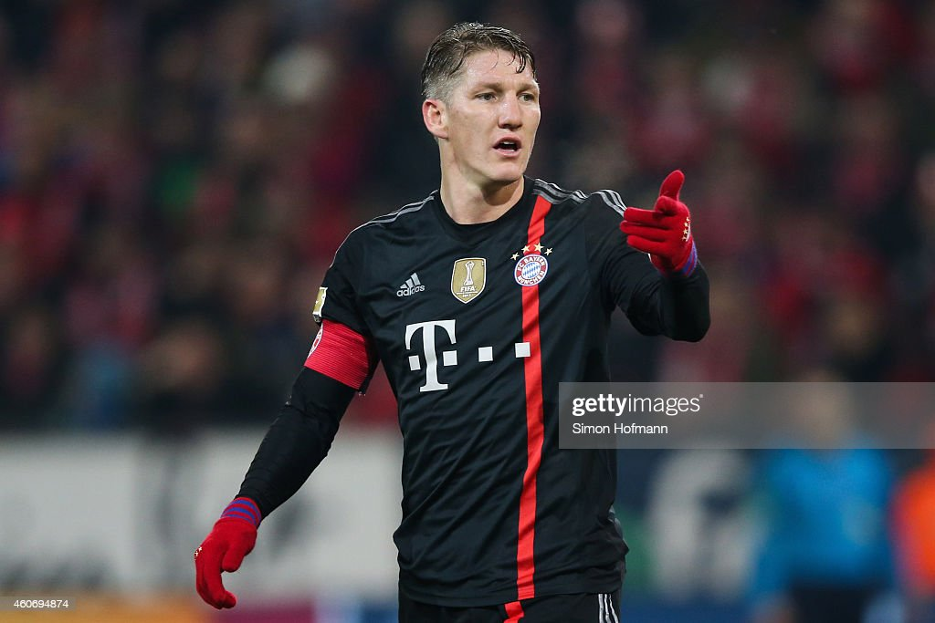 Bastian Schweinsteiger of Muenchen gestures during the Bundesliga match between 1. FSV Mainz 05 and FC Bayern Muenchen at Coface Arena on December 19, 2014 in Mainz, Germany.