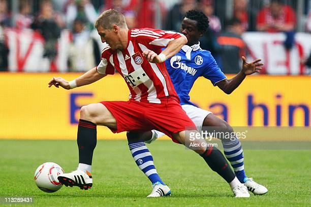 Bastian Schweinsteiger of Muenchen is challenged by Anthony Annan of Schalke during the Bundesliga match between FC Bayern Muenchen and FC Schalke 04...