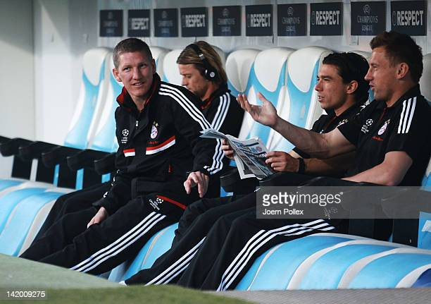 Bastian Schweinsteiger of Muenchen is seen on the bench prior to the UEFA Champions League Quarter Final first leg match between Olympique de...