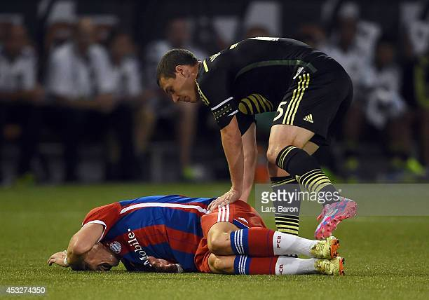 Bastian Schweinsteiger of Muenchen lies on the pitch after a tackle of Matt Besler of MLS All-Stars during the MLS All-Star game between the MLS...