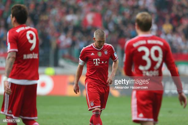 Bastian Schweinsteiger of Muenchen reacts after the Bundesliga match between FC Augsburg and FC Bayern Muenchen at SGL Arena on April 5 2014 in...