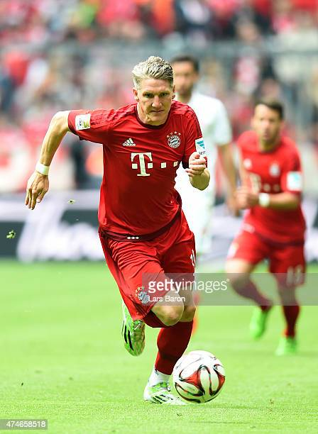 Bastian Schweinsteiger of Muenchen runs with the ball during the Bundesliga match between FC Bayern Muenchen and 1 FSV Mainz at Allianz Arena on May...