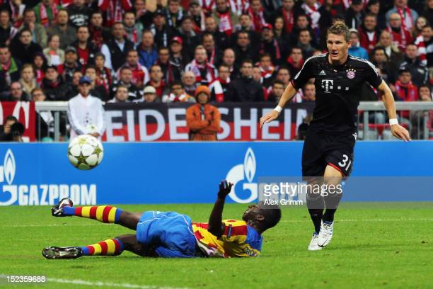 Bastian Schweinsteiger of Muenchen scores his team's first goal against Aly Cissokho of Valencia during the UEFA Champions League group F match...