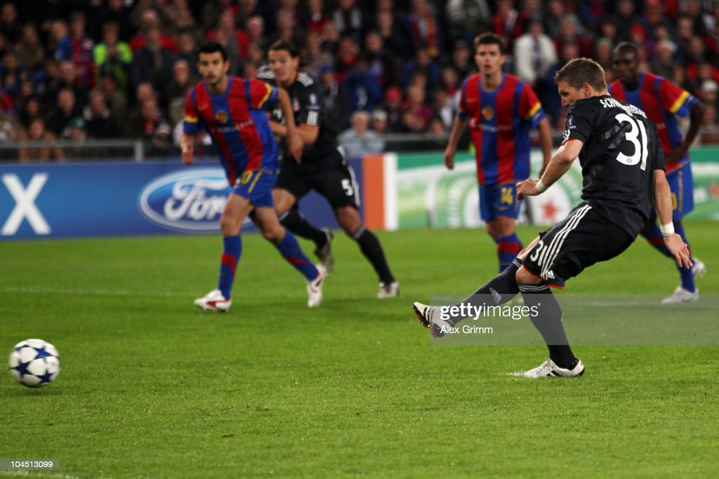 Bastian Schweinsteiger of Muenchen scores his team's first goal from the penalty spot during the UEFA Champions League group E match between FC Basel and FC Bayern Muenchen at the St. Jakob Park stadium on September 28, 2010 in Basel, Switzerland.