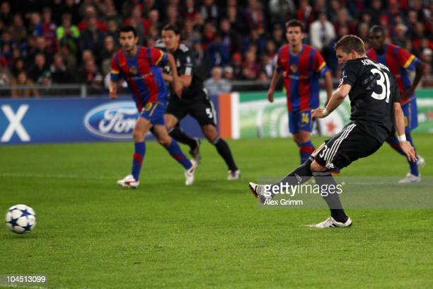 Bastian Schweinsteiger of Muenchen scores his team's first goal from the penalty spot during the UEFA Champions League group E match between FC Basel...