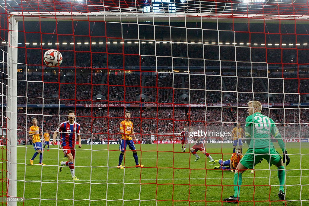 Bastian Schweinsteiger (C) of Muenchen scores the opening goal during the Bundesliga match between FC Bayern Muenchen and Hertha BSC Berlin at Allianz Arena on April 25, 2015 in Munich, Germany.