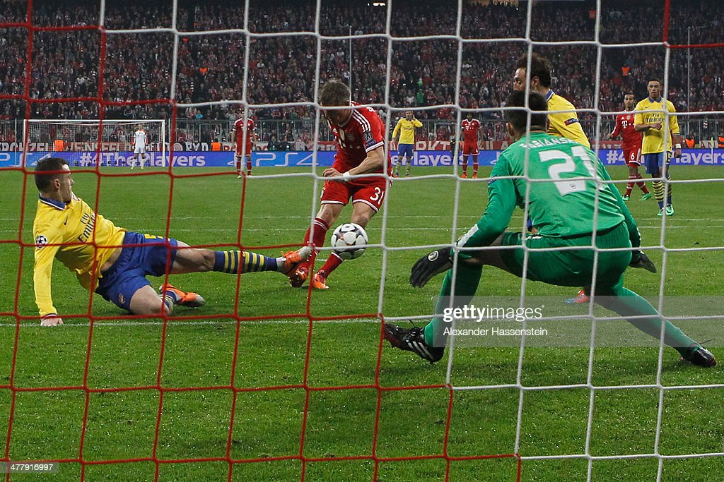 Bastian Schweinsteiger (C) of Muenchen scores the opening goal during the UEFA Champions League Round of 16 second leg match between FC Bayern Muenchen and Arsenal FC at Allianz Arena on March 11, 2014 in Munich, Germany.
