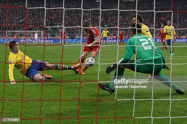 Bastian Schweinsteiger of Muenchen scores the opening goal during the UEFA Champions League Round of 16 second leg match between FC Bayern Muenchen...