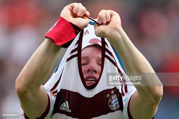 Bastian Schweinsteiger of Muenchenchanges his match jersey during the half time break of Bundesliga match between Sport Club Freiburg and FC Bayern...