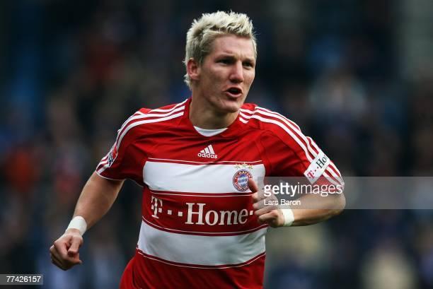 Bastian Schweinsteiger of Munich celebrates scoring the third goal during the Bundesliga match between VfL Bochum and FC Bayern Munich at the...