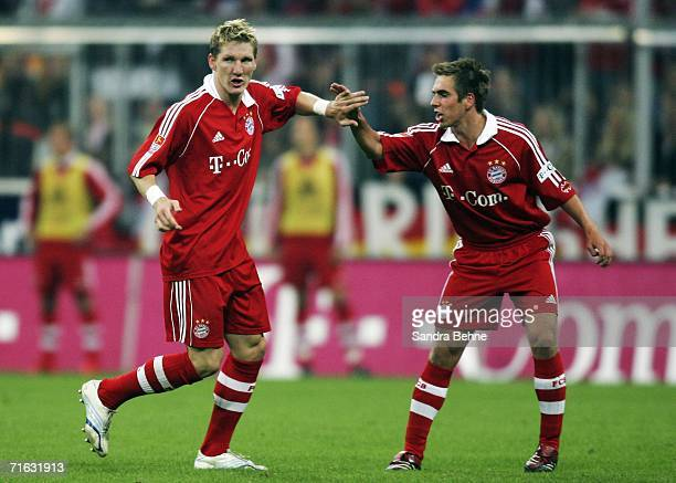 Bastian Schweinsteiger of Munich celebrates the second goal with his team mate Philipp Lahm during the Bundesliga match between FC Bayern Munich and...