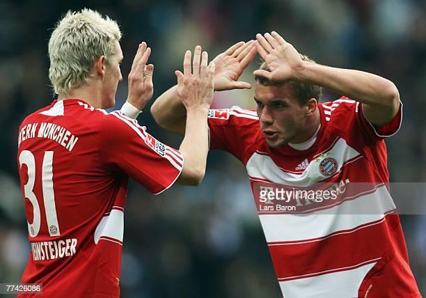 Bastian Schweinsteiger of Munich celebrates with team mate Lukas Podolski after winning the Bundesliga match between VfL Bochum and FC Bayern Munich...