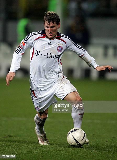 Bastian Schweinsteiger of Munich runs with the ball during the DFB German Cup third round match between Alemannia Aachen and Bayern Munich at the...