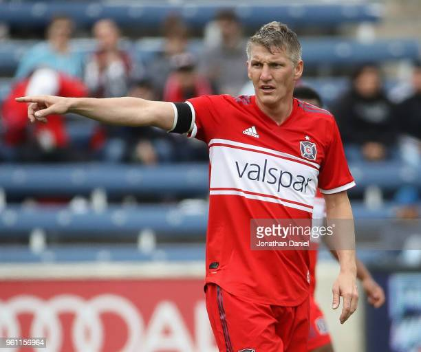 Bastian Schweinsteiger of the Chicago Fire gives instructions to teammates against the Houston Dynamo at Toyota Park on May 20 2018 in Bridgeview...