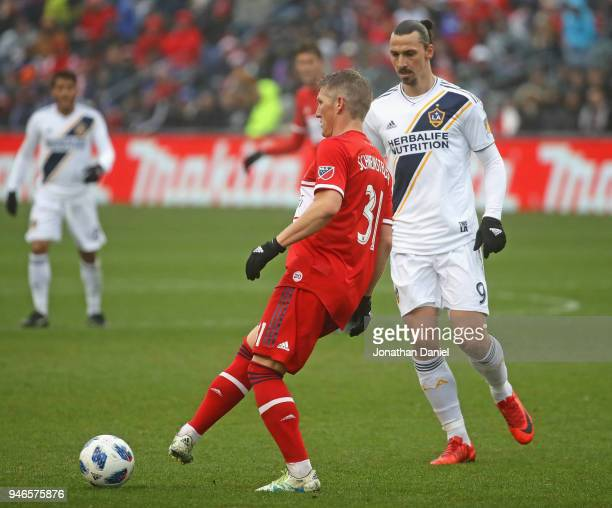 Bastian Schweinsteiger of the Chicago Fire passes away from Zlatan Ibrahimovic of the Los Angeles Galaxy at Toyota Park on April 14 2018 in...