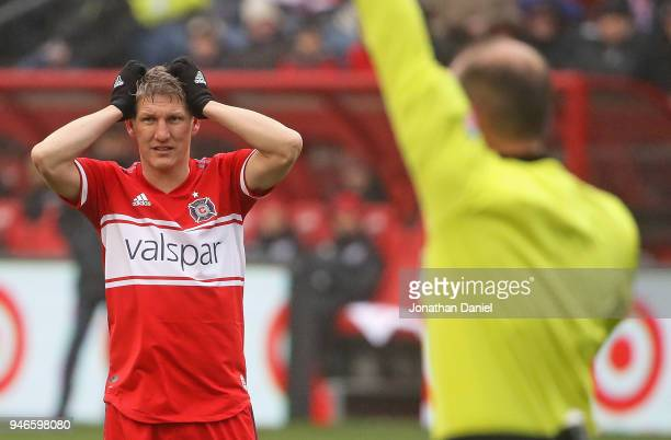 Bastian Schweinsteiger of the Chicago Fire reacts to the referee's decision during a match against the Los Angeles Galaxy at Toyota Park on April 14...