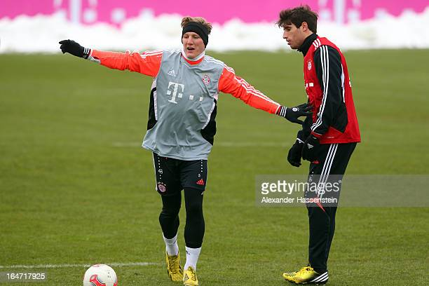 Bastian Schweinsteiger plays with his team mates Javie Martinez during a FC Bayern Muenchen training session at Bayern`s trainings ground Saebener...