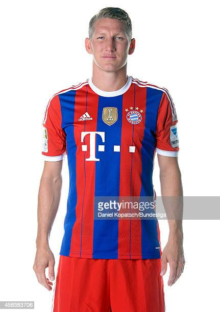Bastian Schweinsteiger poses during the FC Bayern Muenchen Team Presentation for DFL on August 9 2014 in Munich Germany