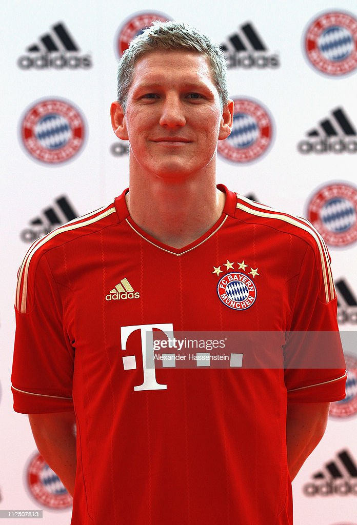 Bastian Schweinsteiger poses in the new FC Bayern Muenchen home jersey for the season 2011/12 at Allianz Arena on April 19, 2011 in Munich, Germany.