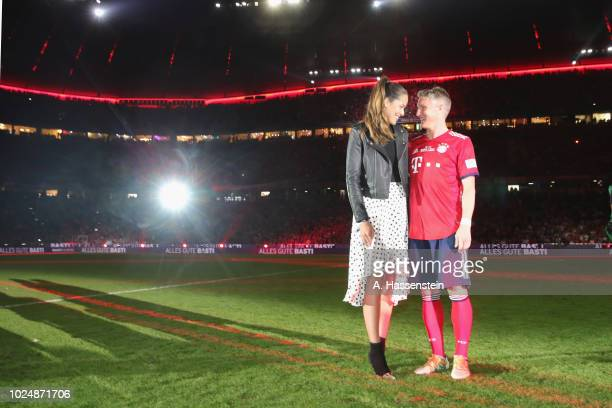 Bastian Schweinsteiger reacts with his wife Ana Ivanovic after the Friendly Match between FC Bayern Muenchen and Chicago Fire at Allianz Arena on...