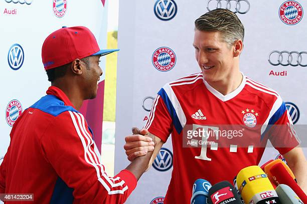 Bastian Schweinsteiger shakes hands with his fan Mukthar JJ during a press conference during day 4 of the Bayern Muenchen training camp at ASPIRE...