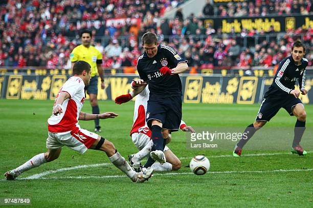 Bastian Schweinsteiger shoots on goal during the Bundesliga match between 1 FC Koeln and FC Bayern Muenchen at RheinEnergieStadion on March 6 2010 in...