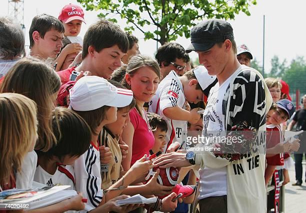 Bastian Schweinsteiger signs autographs at Bayern's training ground Saebener Strasse on April 29 2007 in Munich Germany