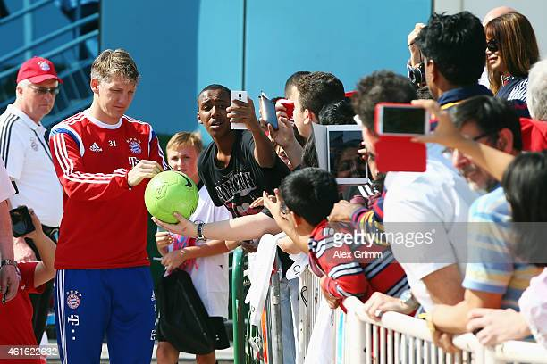 Bastian Schweinsteiger signs autographs during day 8 of the Bayern Muenchen training camp at ASPIRE Academy for Sports Excellence on January 16 2015...
