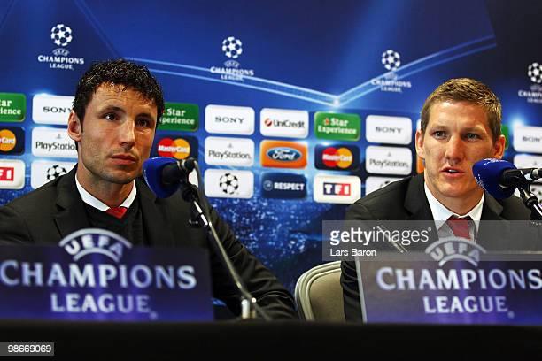 Bastian Schweinsteiger speaks next to team mate Mark van Bommel during a Bayern Muenchen press conference on April 26 2010 in Lyon France Muenchen...
