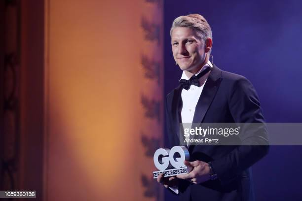Bastian Schweinsteiger speaks on stage after receiving the 'Sports Icon' Award during the GQ Men of the Year Award show at Komische Oper on November...