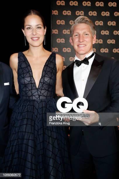 Bastian Schweinsteiger Sports Icon Awardwinner and his wife Ana Schweinsteiger are seen on stage during the GQ Men of the Year Award show at Komische...