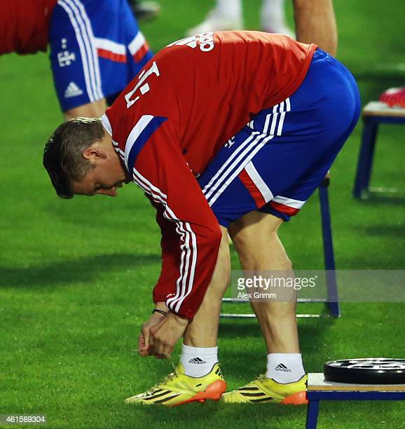 Bastian Schweinsteiger ties his shoes during day 7 of the Bayern Muenchen training camp at ASPIRE Academy for Sports Excellence on January 15, 2015...