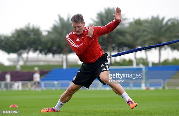 Bastian Schweinsteiger trains during a training session at day 2 of the Bayern Muenchen training camp at ASPIRE Academy for Sports Excellence on...