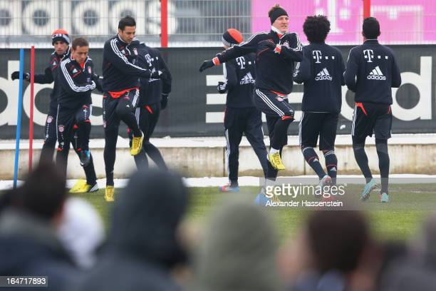 Bastian Schweinsteiger warms up with his team mates during a FC Bayern Muenchen training session at Bayern`s trainings ground Saebener strasse on...