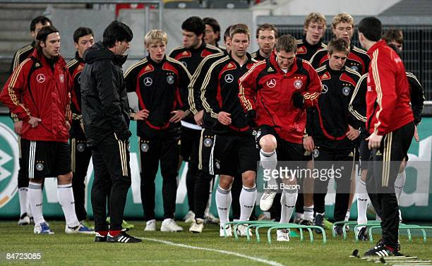 Bastian Schweinsteiger warms up with team mates during a German national team training session on February 10 2009 in Duesseldorf Germany