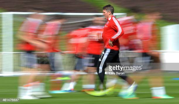 Bastian Schweinsteiger warms up with team mates during a training session at day 5 of the Bayern Muenchen training camp at ASPIRE Academy for Sports...