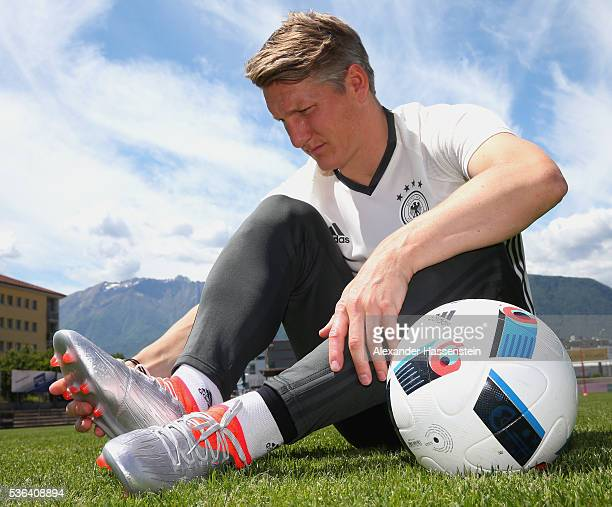Bastian Schweinsteiger with his new Adidas football boots from the new Mercury Pack which were hand delivered by a skydive team on May 25 2016 in...