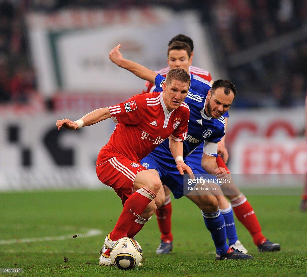 Bastian Schweinstieger of Bayern is challenged by Heiko Westermann of Schalke during the Bundesliga match between FC Schalke 04 and FC Bayern Muenchen at the Veltins Arena on April 3, 2010 in Gelsenkirchen, Germany.