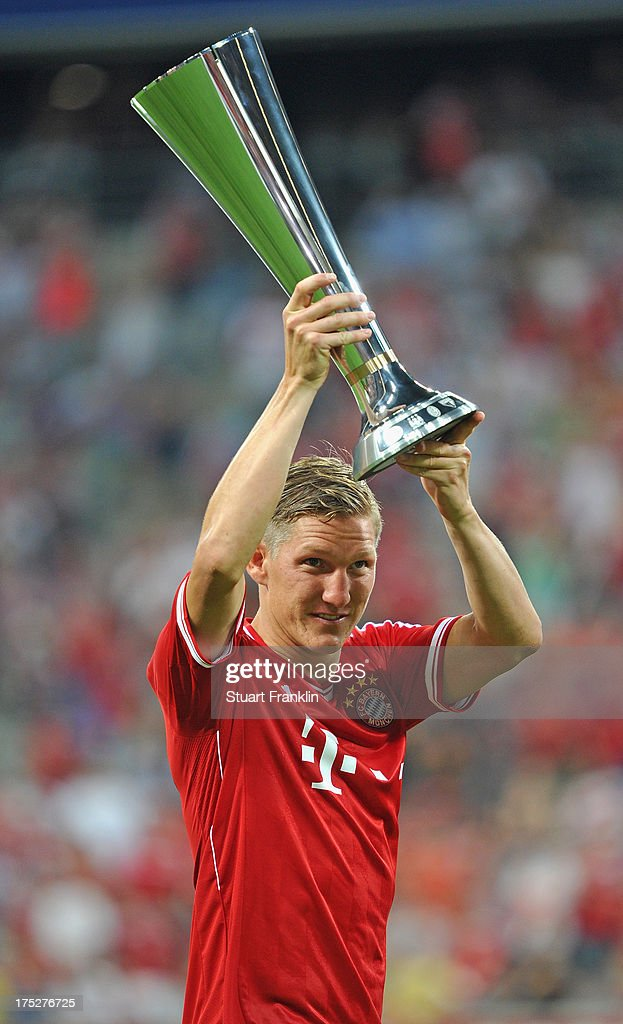 Bastian Schweinstieger of Muenchen holds the winners trophy after the Audi cup 2013 final between FC Bayern Muenchen and Manchester City at Allianz Arena on August 1, 2013 in Munich, Germany.