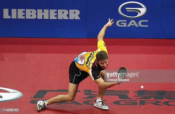 Bastian Steger of Germany plays a backhand during the third round Men's Single match between Bastian Steger of Germany and Leung Chu Yuan of...
