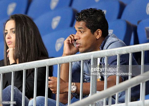 Bastia's Brazilian forward Brandao speaks on the phone from the stands before the French L1 football match between Bastia and Lorient at the Armand...
