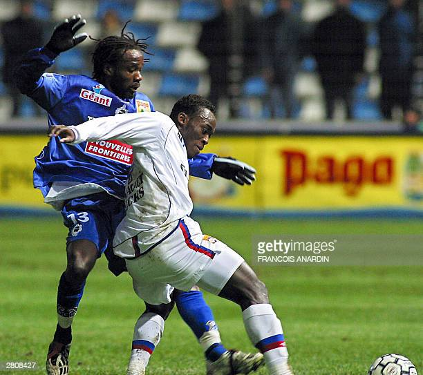 Bastia's defender Pascal Chimbonda vies with Lyon's midfielder Mickael Essien during their French L1 soccer match at the stadium Armand Cesari in...