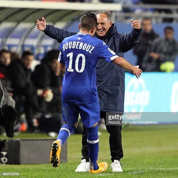 Bastia's Franco Algerian midfielder Ryad Boudebouz is congratulated by Bastia's head coach Ghislain Printant after scoring a goal during the French...
