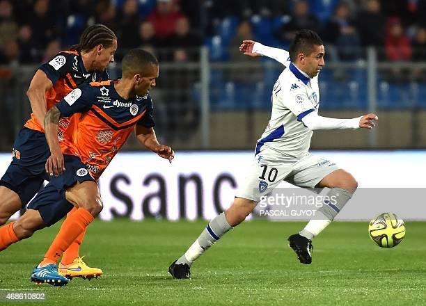 Bastia's Franco Algerian midfielder Ryad Boudebouz vies with Montpellier's French midfielder Joris Marveaux and Montpellier's French defender Daniel...