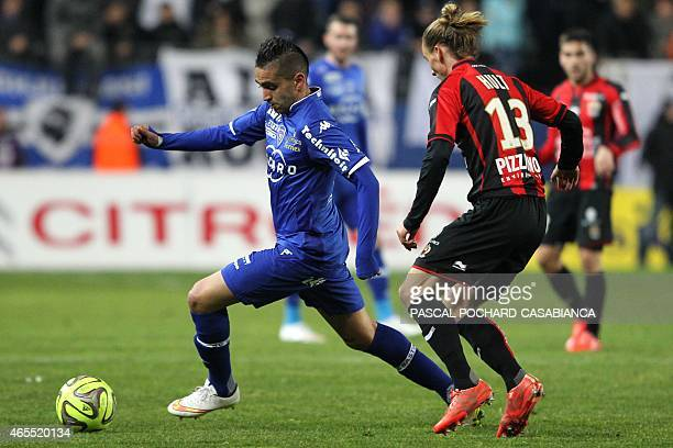 Bastia's Franco Algerian midfielder Ryad Boudebouz vies with Nice's Swedish midfielder Niklas Hult during the French L1 football match Bastia against...