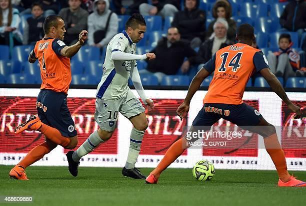 Bastia's FrancoAlgerian midfielder Ryad Boudebouz vies with Montpellier's French midfielder Bryan Dabo and Montpellier's Brazilian defender Vitorino...