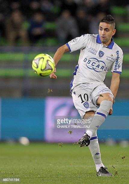 Bastia's French Algerian midfielder Ryad Boudebouz passes the ball during the French L1 football match between Caen and Bastia on December 20 at the...