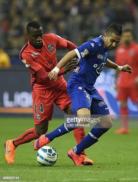 Bastia's French Algerian midfielder Ryad Boudebouz vies with Paris SaintGermain's French midfielder Blaise Matuidi during the French League Cup final...