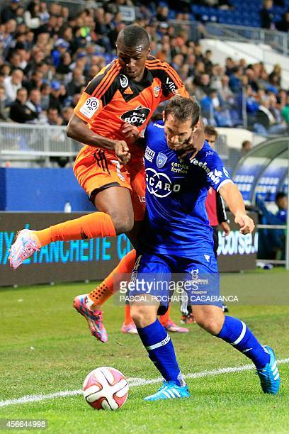 Bastia's French defender Florian Marange challenges Lorient's Guinean forward Sadio Diallo during the French L1 football match between Bastia and...