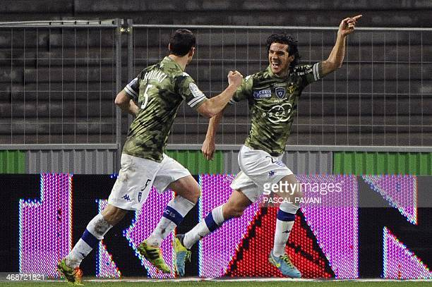 Bastia's French defender Francois Joseph Modesto celebrates with teammates after scoring a goal during the French L1 football match Toulouse against...